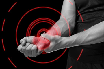 Pain in a male wrist,  pain area of red color