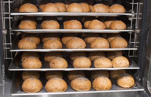 Fototapeta Rye bread rolls baked in the oven