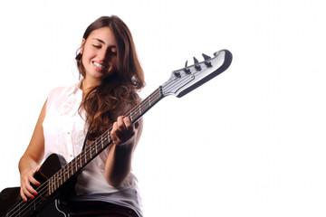 Young girl playing on bass guitar