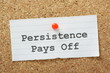 Persistence Pays Off on a cork notice board
