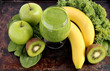 Green smoothie with spinach, kale, kiwi, green apples, bananas
