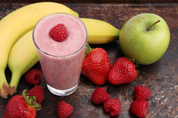 Raspberry smoothie with strawberries, green apples and bananas