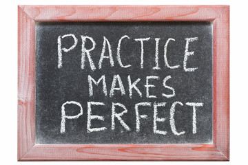 practice makes perfect phrase handwritten on vintage blackboard
