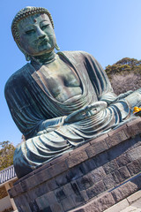 Kamakura,Japan - March 23 , 2014 : Great Buddha against blue sky