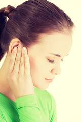 Young woman feeling a pain in ear