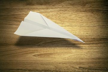 paper plane wooden desk