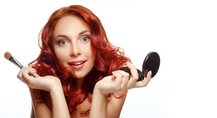 Beauty portrait of pretty ginger woman with brush for makeup and