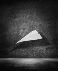 paper plane dark room