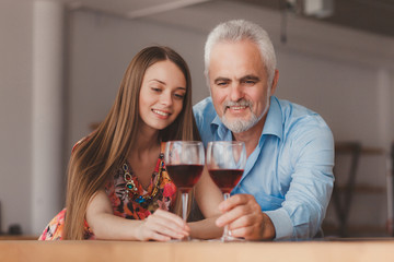 couple holding wine glasess