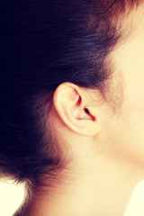 Young caucasian woman ear.