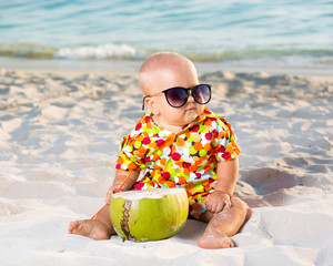 Baby with coconut