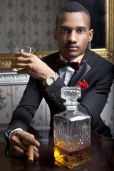 Elegante handsome black gentleman drinks scotch whiskey