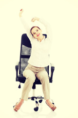 Beautiful business woman relaxing on a chair.