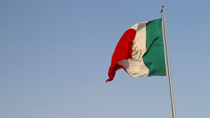 Big Mexico flag on Zocalo in Mexico City against clear blue sky