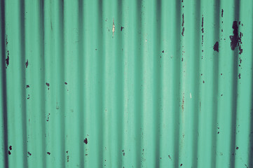 Green color of  corrugated iron wall