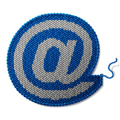 Mail sign of knitted fabric isolated on white background
