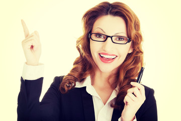 Happy business woman showing copy space