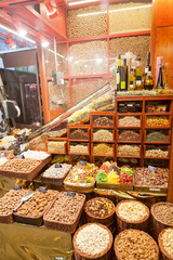 counter with a variety of nuts, spices and dried fruit