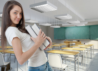 Young woman with books at school
