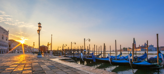 View of Venice with gondolas at sunrise