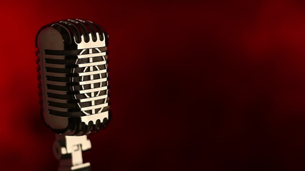 Retro microphone in front of red smoke background