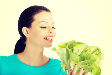 Attractive smiling woman with fresh salat