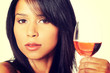 Beautiful woman with glass of rose wine
