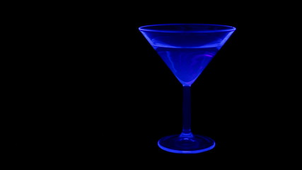 Cocktail in a club with UV (black light) and green laser