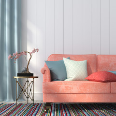 Salmon-colored sofa and a metal table