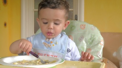 little child eating soup