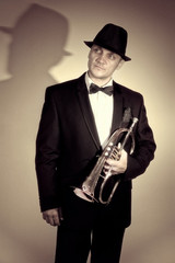 Stylish trumpeter holding the flugelhorn