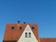 Wohnhaus mt rotbraunem Ziegeldach und Dachfenstern in Helpup