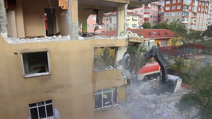 Demolition of a house with a digger