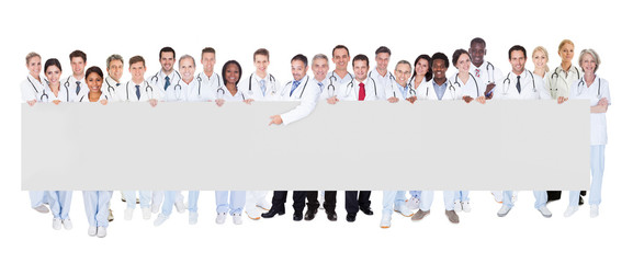 Multiethnic Doctors Holding Blank Banner