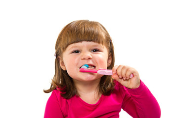 Adorable child learning to brush teeth, isolated on