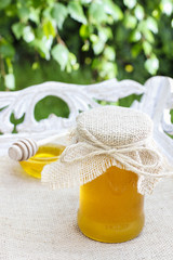 Jar of honey on wooden table