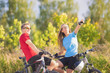 Mountain Bikers Standing and Resting in Forest Surroundings  in
