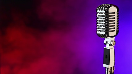 Vintage microphone on red and blue smoke background