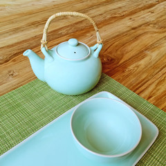 Table setting and blue teapot