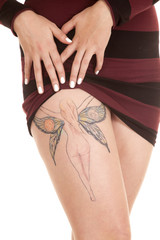 woman show fairy tattoo on leg