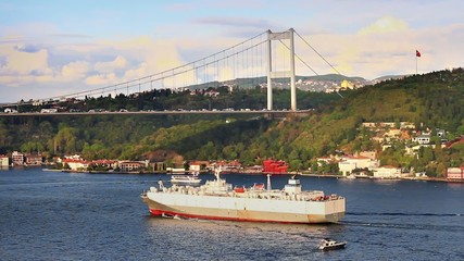 Istanbul FSM Bridge with a large vehicles carrier passing under