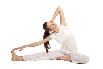 young beautiful yoga posing on a studio background24