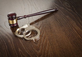Gavel and Pair of Handcuffs on Table