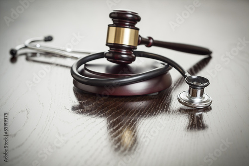 Gavel and Stethoscope on Reflective Table - 65919375