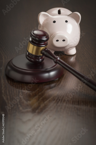 Poster Gavel and Piggy Bank on Table
