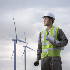 Asian industrial engineer checking winturbines