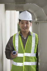 Asian industrial engineer at work