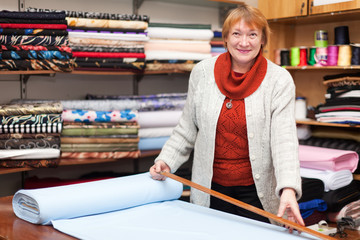 woman  works at  fabric store