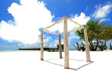 Wood structre with overwater villas in Maldives