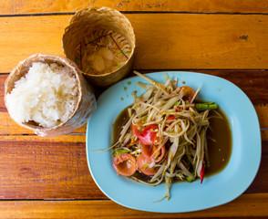 som tam thai, green papaya salad, sticky rice in bamboo
